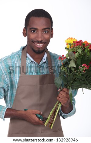 florist with bouquet of flowers on white background - stock photo