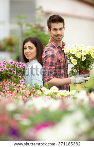 florists man and woman working in the greenhouse
