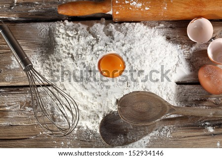 flour and desk of wood  - stock photo