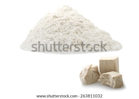 Flour and Yeast cubes close up on the white - stock photo