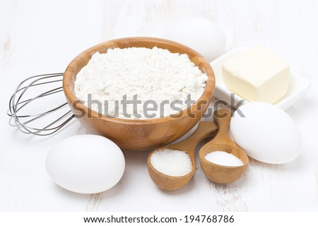 flour, salt, sugar, butter and eggs for baking pancakes, close-up - stock photo