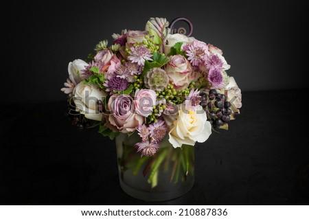 Flower arrangement bouquet on black background - stock photo