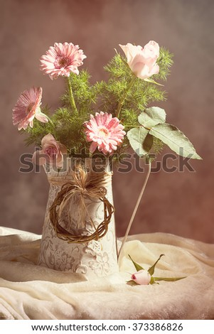 Flower arrangement still life with pink roses and gerbera - stock photo