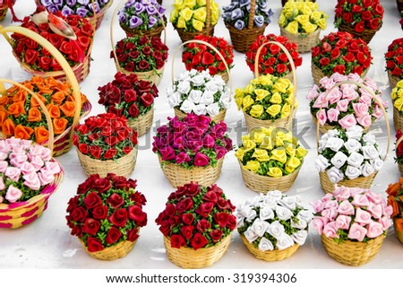 Flower arrangements of colorful flowers in baskets - stock photo
