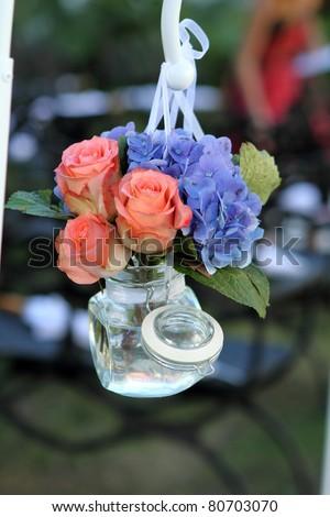 Flower arrangmnet, hanging glass jar, at wedding, - stock photo