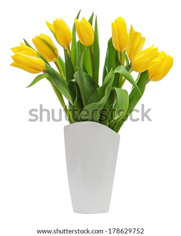 Flower bouquet from yellow tulips in vase isolated on white background. Closeup. - stock photo
