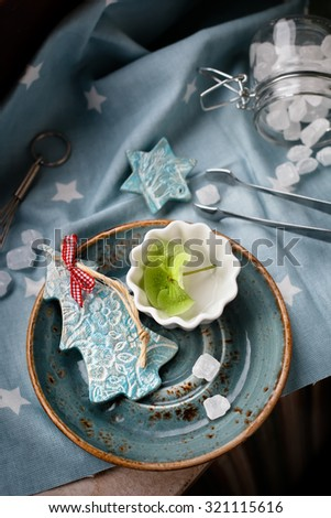 Flower Christmas: xmas decorations, flowers and sweets, overview. Natural light. Lightly toned photo. - stock photo