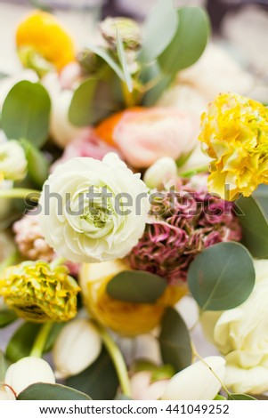 flower composition of ranunculus, tulips and roses