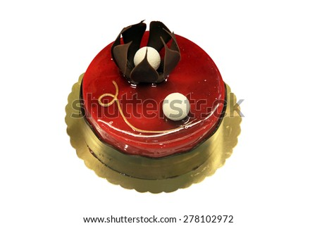 Flower decorates chocolate cake. Isolated on white. - stock photo