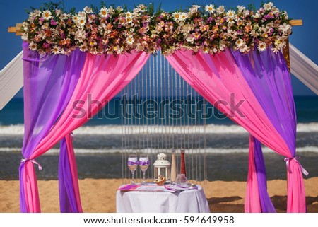 Flower decoration beach wedding venue wedding stock photo royalty flower decoration at the beach wedding venue wedding arch on the beach close up junglespirit Image collections