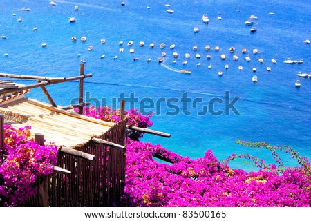 Flower draped terrace in Positano on the Amalfi Coast of Italy - stock photo