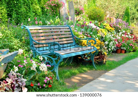 flower garden and vintage bench