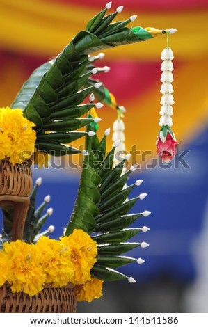 Flower garlands and banana-fold leaves for buddhist religious ceremony - stock photo