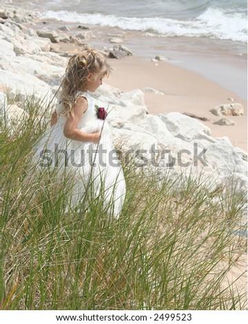 Flower girl on beach - stock photo