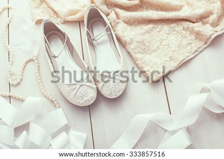 Flower girl silver glitter shoes closeup - stock photo