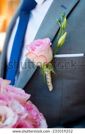 Flower in the buttonhole of his jacket the groom. Wedding bouquet in hands of the bride groom. Wedding day. Wedding decorations. Happy newlyweds. - stock photo