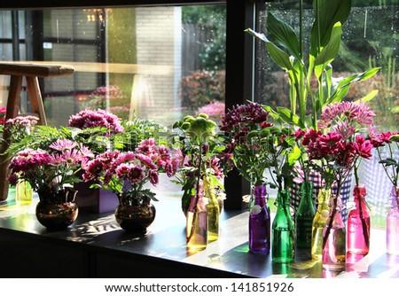 Flower in the stylish handmade vases - stock photo