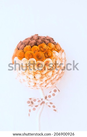 flower made of paper with a bow on a stick - stock photo