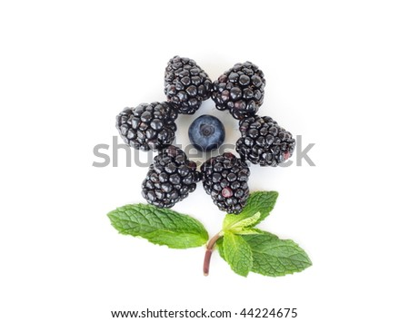 Flower made out of blackberry, blueberry and mint