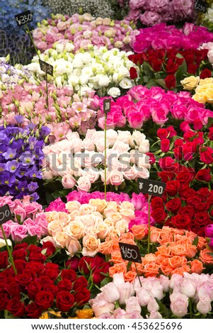 Flower market in Japan. Closeup showing and array of bouquets in various colours and varieties. - stock photo