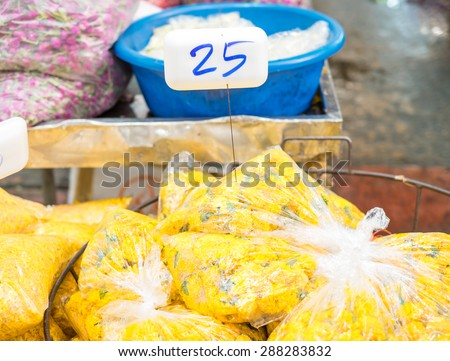 Flower market in Thailand, group of marigold bag sale at market - stock photo