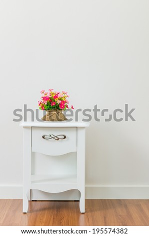 Flower on bedside table - stock photo