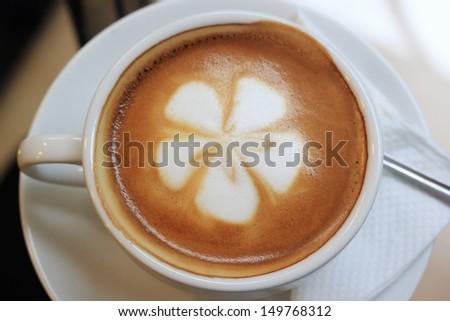 Flower on Latte coffee art - stock photo