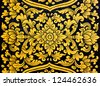 flower pattern in traditional Thai style art painting on window of the temple - stock photo