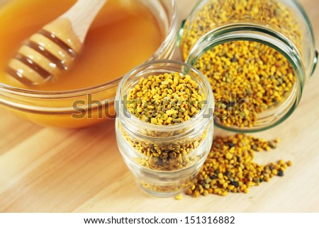 Flower pollen in glass jar and honey - stock photo