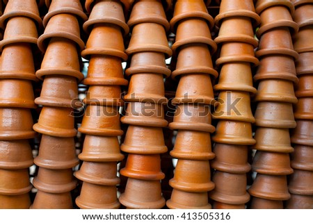 flower pots stacked in rows, background - stock photo