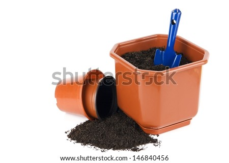Flower pots with soil and shovel isolated on white - stock photo