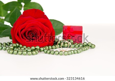 flower red rose with rings and beads - stock photo