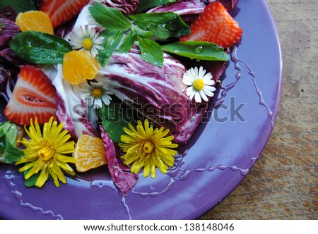 Flower salad whit sweet honey and fruits.