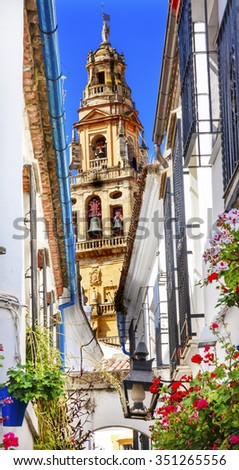 Flower Street Calleja de las Flores Old Torre del Alminar Bell Tower Mezquita Cordoba Andalusia Spain.  Mezquita created Mosque in 785 converted to a Cathedral in 1500.   - stock photo