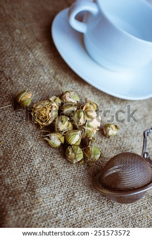 Flower tea rose buds with with tea infuser