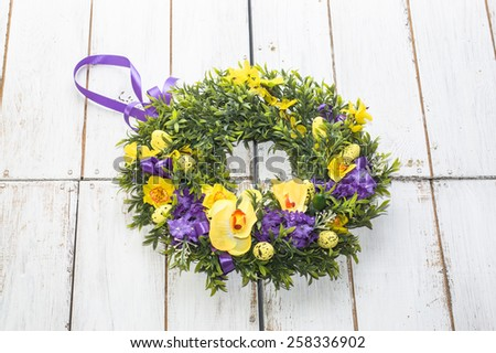 Flower wreath isolated on white vintage wooden background - stock photo