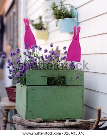 flowerpot of lavender and two rabbits - stock photo