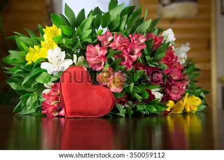 Flowers an alstromeriya on a wooden table - stock photo