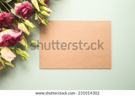 Flowers and cardboard on paper background   - stock photo