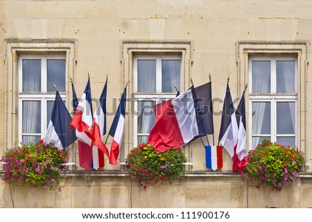 Flowers and flags. Town Hall in Melun. Melun is a commune in the Seine-et-Marne department in Ile-de-France region, France. - stock photo