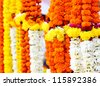Flowers and garlands for sale at the flower market in India - stock photo