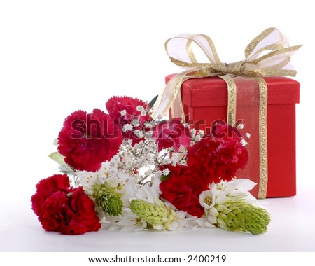 Flowers and gift box, wrapped in red.  Isolated on white.  Focus on front flowers. - stock photo