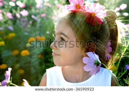 Flowers and the girl. Small depth of focus - stock photo