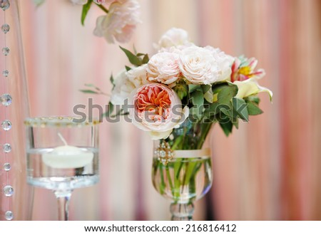 Flowers bouquet and candle as decoration on wedding party - stock photo