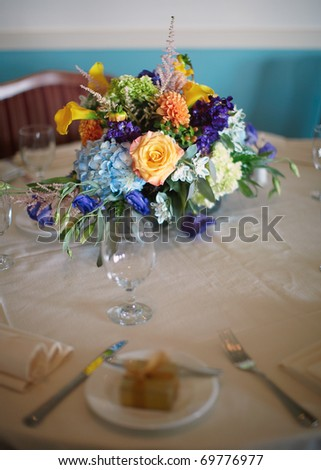 Flowers centerpiece at wedding reception table, shallow DOF focus on bouquet