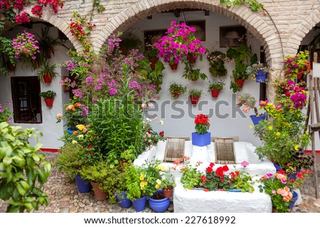 Flowers Decoration of Vintage Courtyard, typical house in Cordoba - Spain, European - 10 of May, 2013 - stock photo