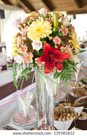 flowers decoration on the table at wedding reception hall - stock photo