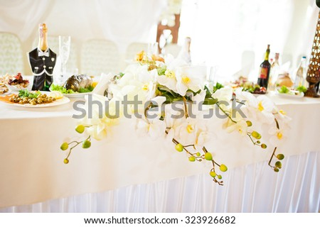 flowers decoration on wedding table - stock photo