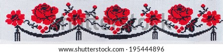 flowers embroidered cross-stitch pattern, ethnic ornament - stock photo