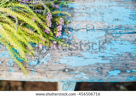 Flowers  from forest arranged on rustic wood background.  Useful as greeting card, postcard or floral decorative background.